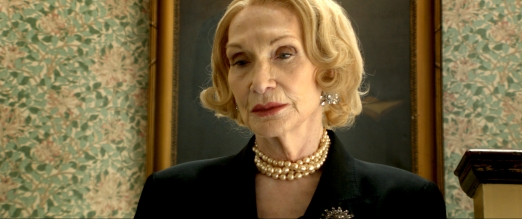 Siân Phillips as Miss Dubois